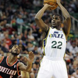 Utah Jazz shooting guard Justin Holiday (22) shoots in front of Portland Trail Blazers shooting guard Will Barton (5) in the second half of a game at the Energy Solutions Arena on Wednesday, October 16, 2013.