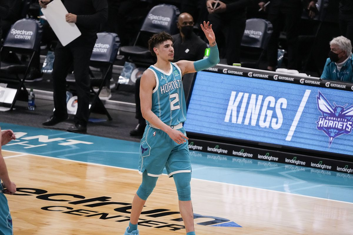 Charlotte Hornets guard LaMelo Ball acknowledges cheers after a three-point shot against the Toronto Raptors during the first quarter at Spectrum Center.