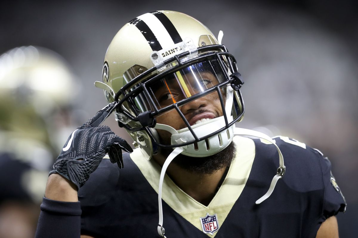 NEW ORLEANS, LA:  New Orleans Saints defensive back Marshon Lattimore (23) adjusts his chinstrap during warmups before a game against the Carolina Panthers in the NFC Playoffs Wild Card Round at the Mercedes-Benz Superdome.