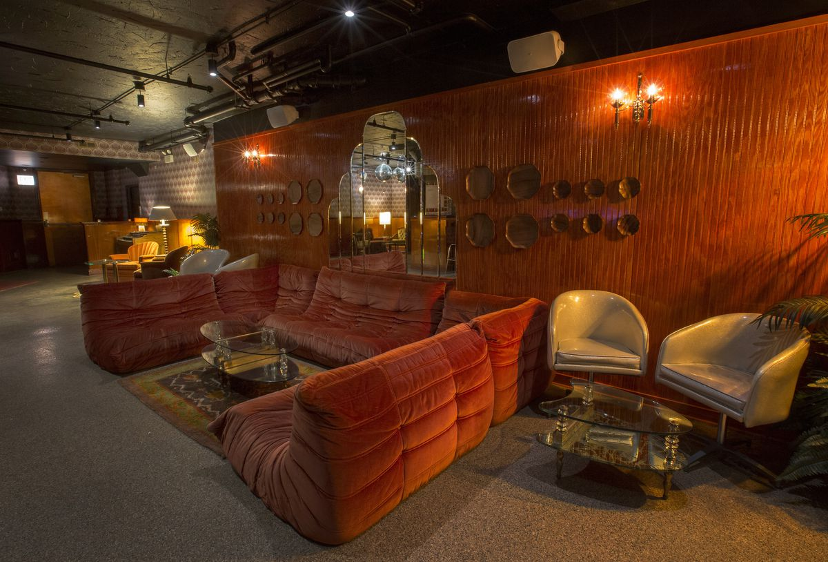 A giant shaggy organ couch, gray lounge chairs, and more.