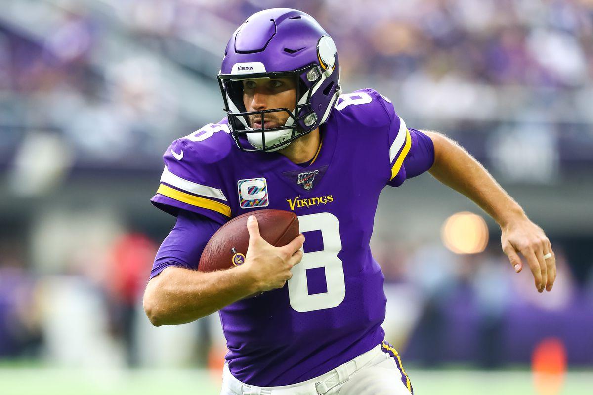 Minnesota Vikings quarterback Kirk Cousins runs with the ball in the first quarter against the Philadelphia Eagles at U.S. Bank Stadium.