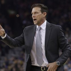 Utah Jazz coach Quin Snyder gestures during the first half of the team's NBA basketball game against the Golden State Warriors in Oakland, Calif., Wednesday, Dec. 27, 2017. (AP Photo/Jeff Chiu)