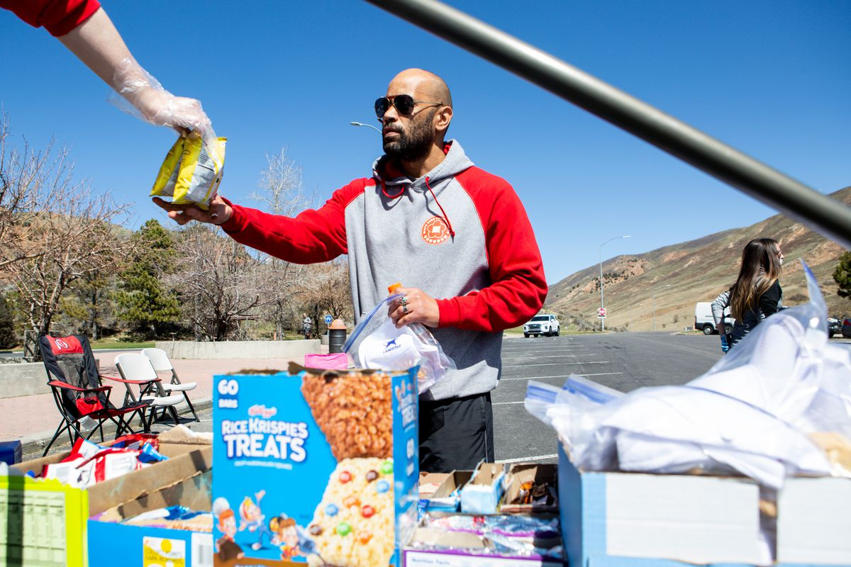 """Justin Lewandowski, a truck driver, gets free snacks at a rest stop along I-80 in Echo, Summit County, on Friday, April 10, 2020, during a thank-you event for truckers. """"It's easy to be a good Samaritan on Facebook, everybody's like 'thank a trucker.'... This is the first time that I've actually seen somebody doing something,"""" Lewandowski said. """"It hits other people a lot worse than me, but it affects everybody to some degree."""" The companies involved were Granite 3PL, Landstar, Statewide Transportation, LS Wilson, Wilson Brothers and Mac Tranz Inc. in Echo along I-80 West bound on Friday, April 10, 2020. Volunteers with different trucking companies organized the event and gave away about 200 hot dogs since they started at 10 a.m. """"It's easy to be a good samaritan on Facebook, everybody's like 'thank a trucker,'…this is the first time that I've actually seen somebody doing something,"""" Lewandowski said. """"It hits other people a lot worse than me, but it effects everybody to some degree."""" The companies involved were Granite 3pl, Landstar, Statewide Transportation, LS Wilson, Wilson Brothers and Mac Tranz Inc."""