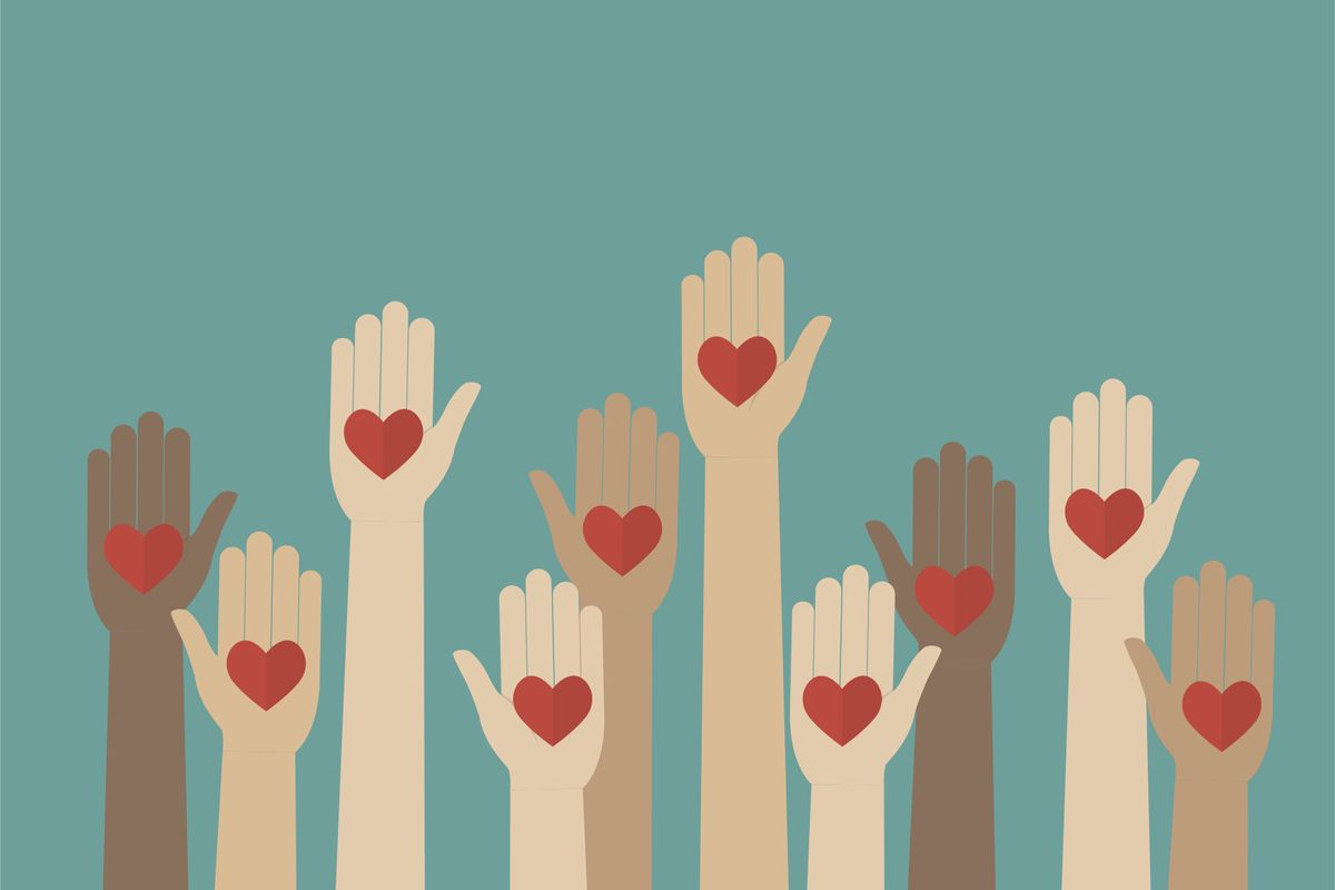 An illustration of raised hands, each with a heart on its palm.