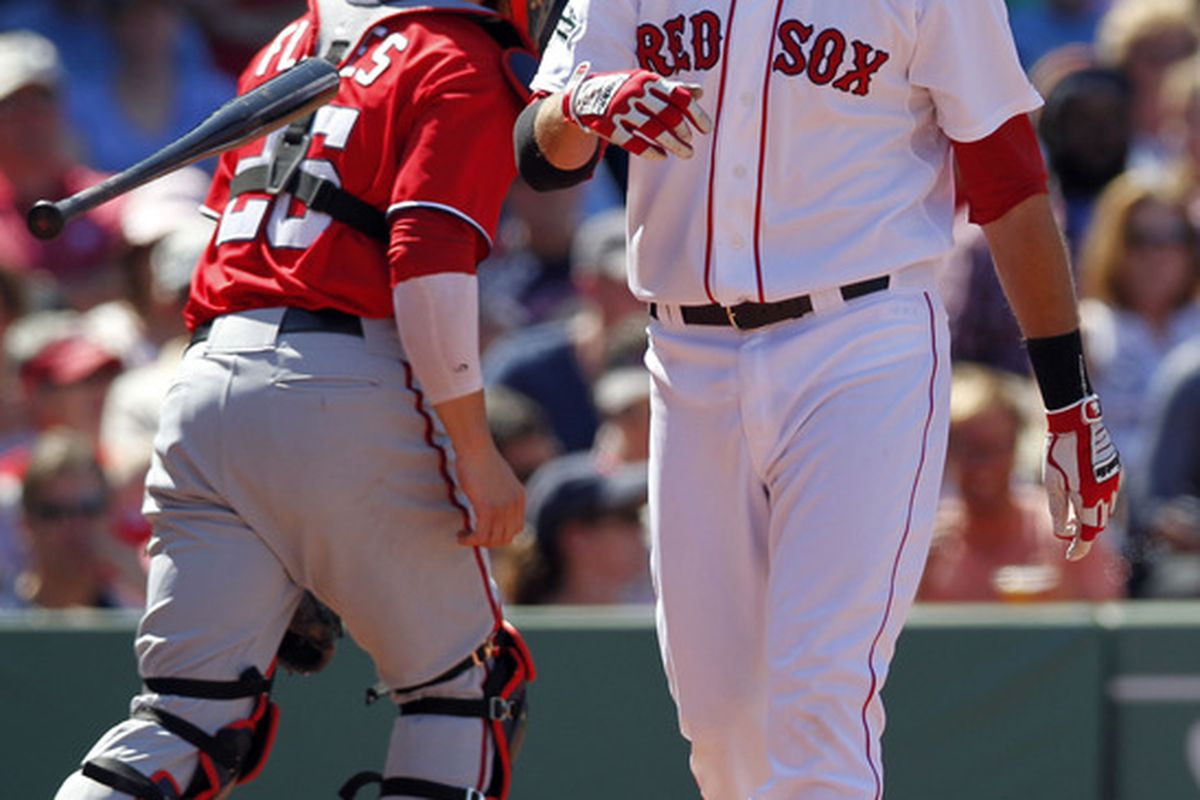 June 10, 2012; Boston, MA, USA; Boston Red Sox third baseman Will Middlebrooks (64) reacts to striking out during the sixth inning against the Washington Nationals at Fenway Park.  Mandatory Credit: Greg M. Cooper-US PRESSWIRE