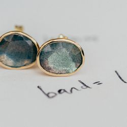 """<a href=""""http://shopthemansion.com/collections/jewelry"""">14k labradorite</a> studs ($365)"""
