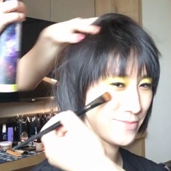Eva Chen getting her glam on. Looks like she'll be wearing a bold yellow eye look tonight.