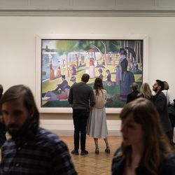 """People stop to view """"A Sunday on La Grande Jatte"""" during Midwinter Fest. 
