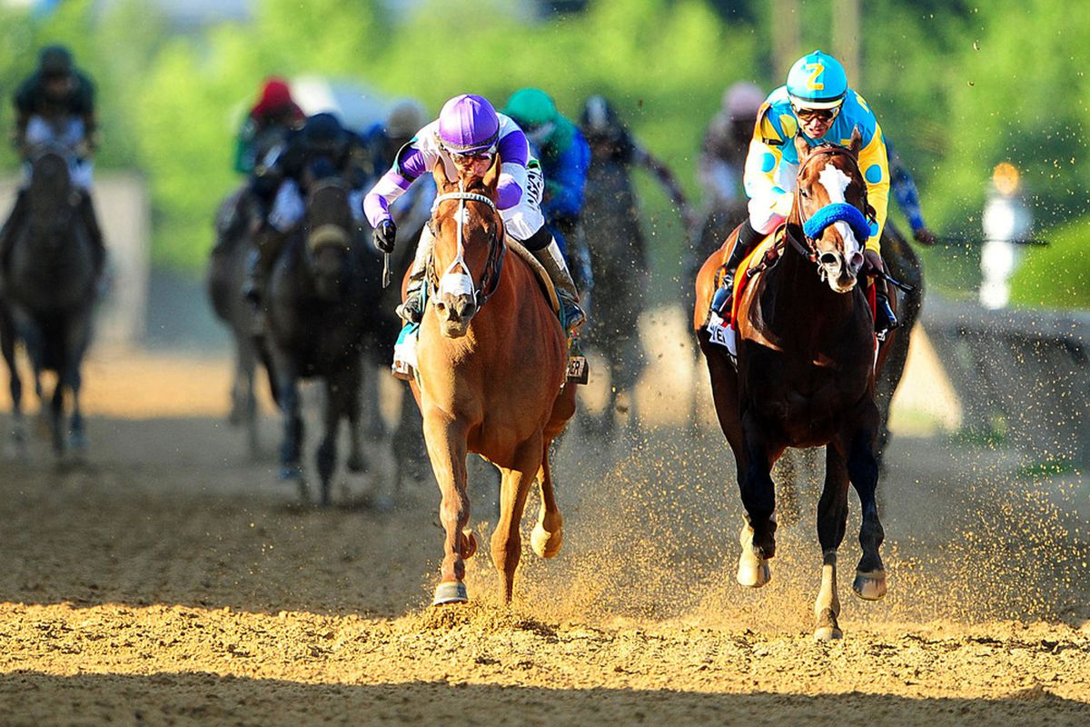 May 19, 2012;Baltimore, MD, USA; Mario Gutierrez aboard I'll Have Another (9) beats Mike E. Smith aboard Bodemeister (7) to win the running of the 137th Preakness Stakes at Pimlico Race Course.  Mandatory Credit: Evan Habeeb-US PRESSWIRE