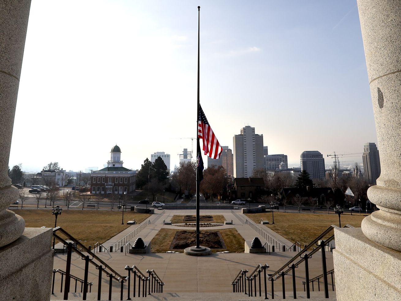The U.S. and state flag fly at half-staff at the state Capitol in Salt Lake City on Monday, Jan. 11, 2021, in honor of Capitol Police officer Brian D. Sicknick, who died from injuries he suffered when supporters of President Donald Trump stormed the U.S. Capitol in Washington on Wednesday, Jan. 6, 2021.