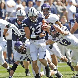 Brigham Young Cougars quarterback Riley Nelson (13) runs thought defenders during the first half as Brigham Young University plays Weber State University in football  Saturday, Sept. 8, 2012, in Provo, Utah.