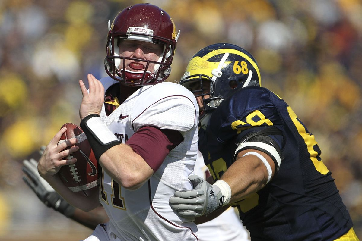 Mike Martin #68 of the Michigan Wolverines sacks Max Shortell #11 of the Minnesota Golden Gophers during the second quarter of the game at Michigan Stadium on October 1, 2011 in Ann Arbor, Michigan.  (Photo by Leon Halip/Getty Images)