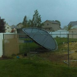 A trampoline in Clinton, Utah, was caught by the wind during Friday's storm, August 7, 2015.