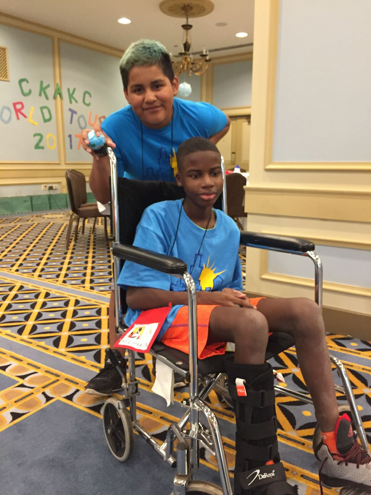 Andres Diaz and Kei'Shaun Hardaway (in chair), both 13, are having fun at Camp Kids Are Kids Chicago, a summer camp for young cancer survivors held this week at the Palmer House Hilton. | Neil Steinberg/Sun-Times