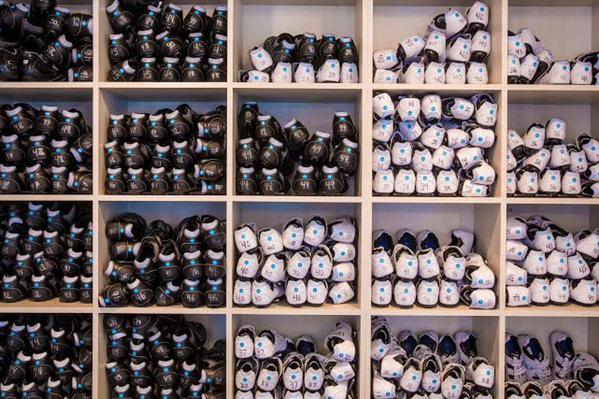 Cubbies of shoes at Flywheel Sports in Tribeca