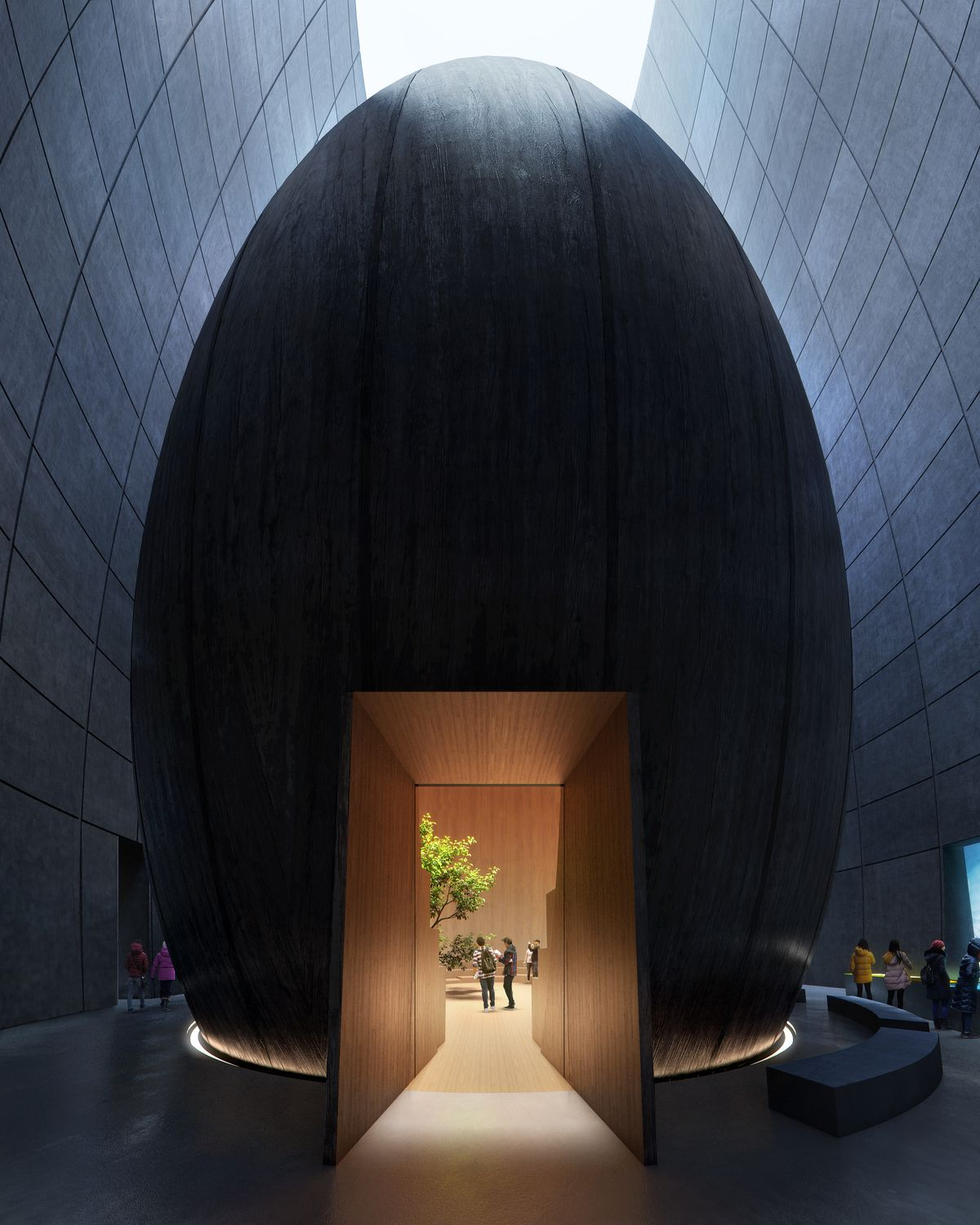 Entrance to black conical visitor center contains a view into an inner chamber with wooden walls and a tree.
