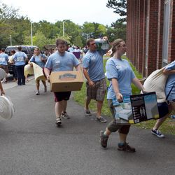 In this photo made Friday, Aug. 31, 2012, blue-shirted upperclassmen help move items belonging to incoming freshman at the University of Maine in Orono. Enrollment at Maine's universities has been dropping for years, but education officials say the worst is over and that the student population should level off this fall following efforts to stem the decline.