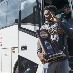 Donte Ingram steps off with the NAACP South Regional Championship trophy. | Tyler LaRiviere/Sun-Times
