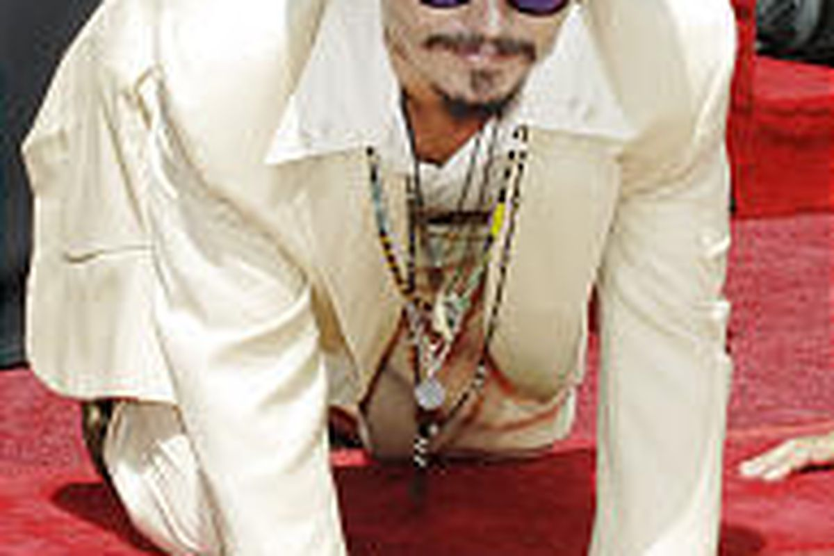 Johnny Depp puts his hands in concrete in the courtyard at Grauman's Chinese Theatre in Los Angeles.