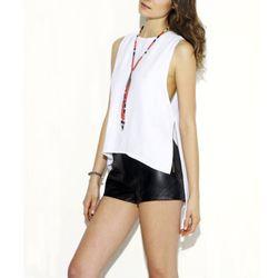 """<b>Veda</b> Agnes top, <a href=""""http://www.thisisveda.com/products/agnes-white"""">$115</a> at <a href=""""http://shopcondor.com/"""">Condor</a>"""