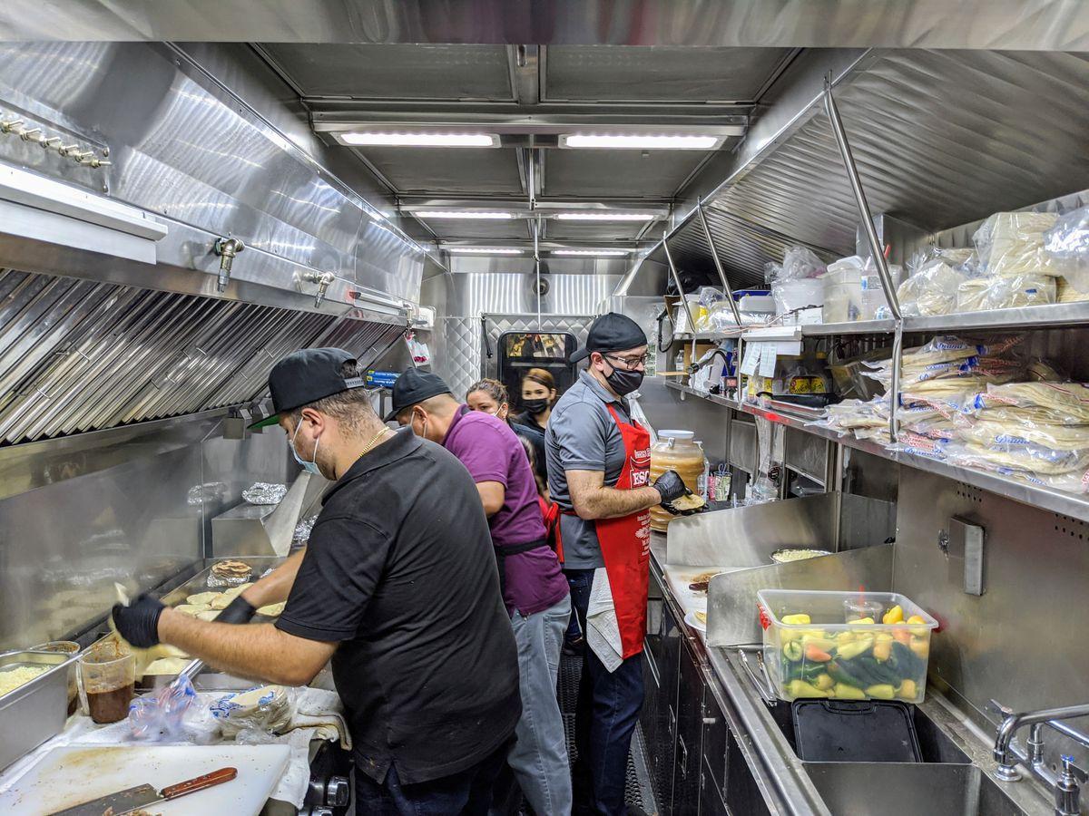 Workers inside La Carreta truck