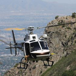 A Utah Department of Public Safety helicopter makes an approach to drop off members of the Salt Lake County Search and Rescue team in an effort to recover the body of a 22-year-old hiker who fell in Bell Canyon on Monday, June 5, 2017. Siaosi Brown's body was spotted in the lower falls of the canyon. His body was trapped on some logs in the middle of the waterfall, Unified Police Lt. Brian Lohrke said.