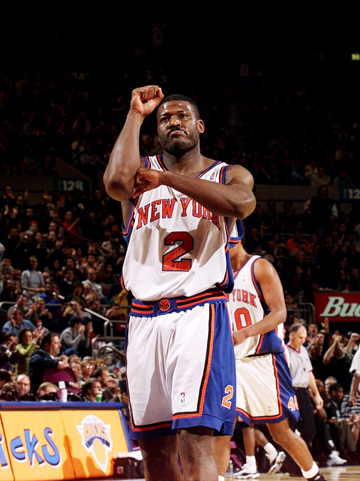The New York Knicks' Larry Johnson gestures to the crowd wit