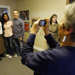 Saratoga Springs Mayor, Mia Love, center left, poses for a photo with her campaign manager Kim Coleman, left, and her husband, Jason, after talking Thursday, Dec. 22, 2011, about her plans to run for Congress at what will become her campaign headquarters in South Jordan.