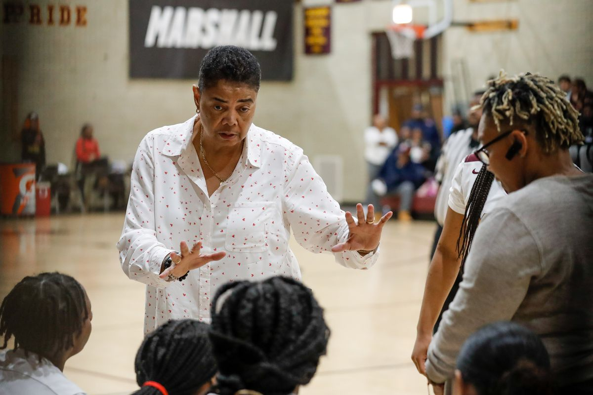 Marshall's coach Dorothy Gaters talks to her players during the game on January 14, 2020.
