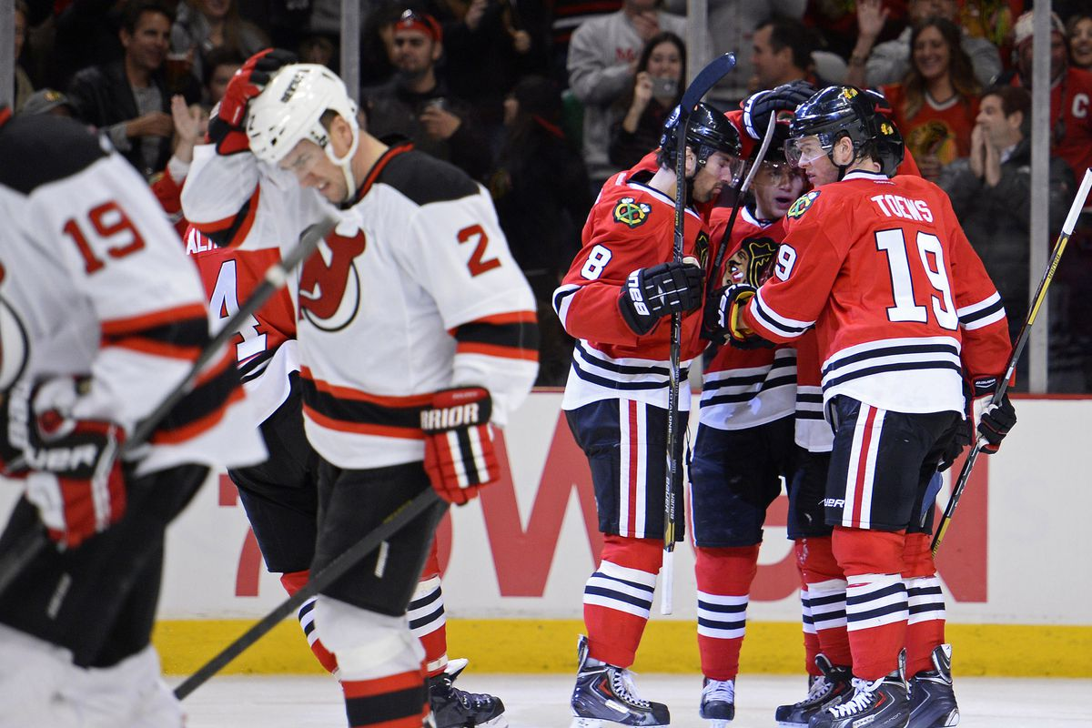 A common scene in Chicago: the Blackhawks celebrating and a Devil looking disappointed.