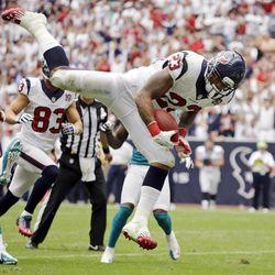 Houston Texans running back Arian Foster (23) leaps into the end zone for a touchdown against the Miami Dolphins in the second quarter of an NFL football game, Sunday, Sept. 9, 2012, in Houston.