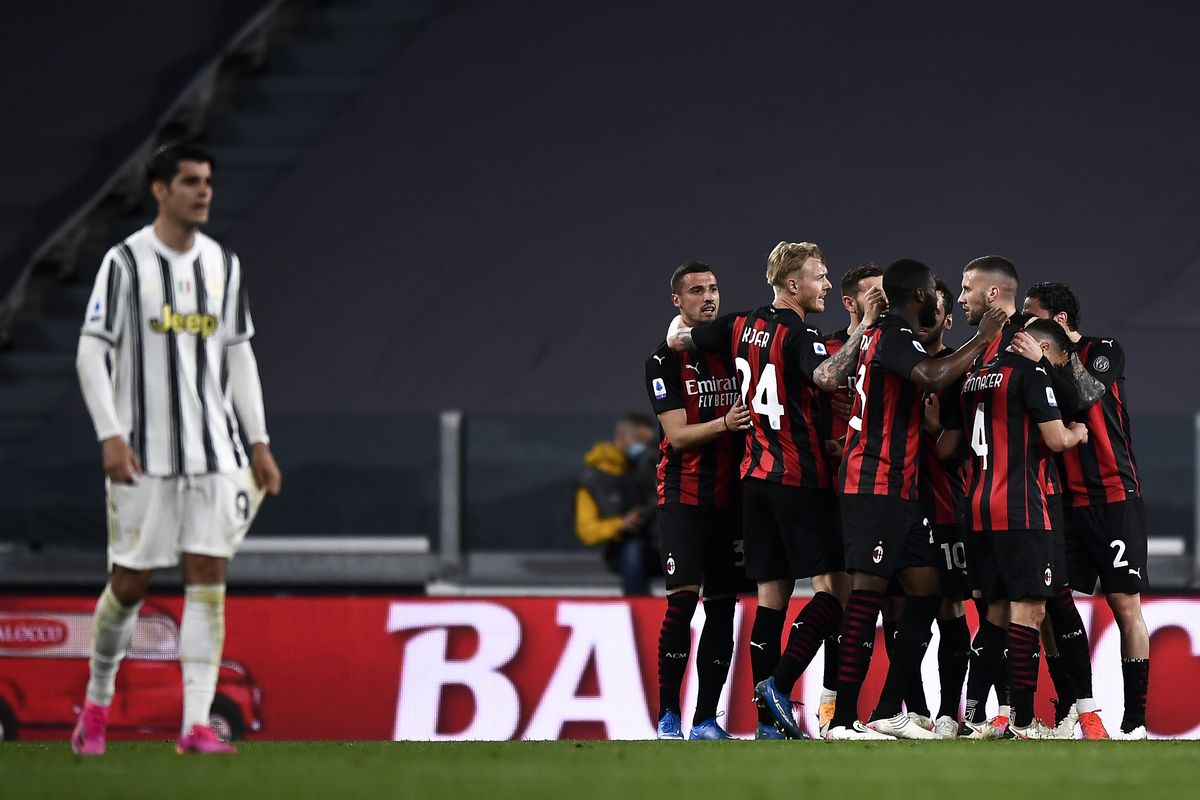 Ante Rebic (C) of AC Milan celebrates with his teammates...