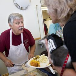 """Ed Snoddy reacts to seeing Jamie Barnard while serving a Thanksgiving meal that he prepared at Grace Mary Manor in South Salt Lake on Tuesday, Nov. 22, 2016. Snoddy refers to Barnard as """"one of his miracles."""" Barnard had been homeless until Snoddy convinced her to move into the supportive housing complex."""