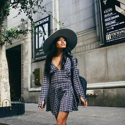 """Olivia of <a href=""""http://lusttforlife.com""""target=""""_blank"""">Lust for Life</a> is wearing a Reformation dress and a <a href=""""http://www.neimanmarcus.com/French-Connection-So-Fresh-Double-Zip-Faux-Leather-Backpack-Black-Handbags/prod174870371_cat46540793__/p"""