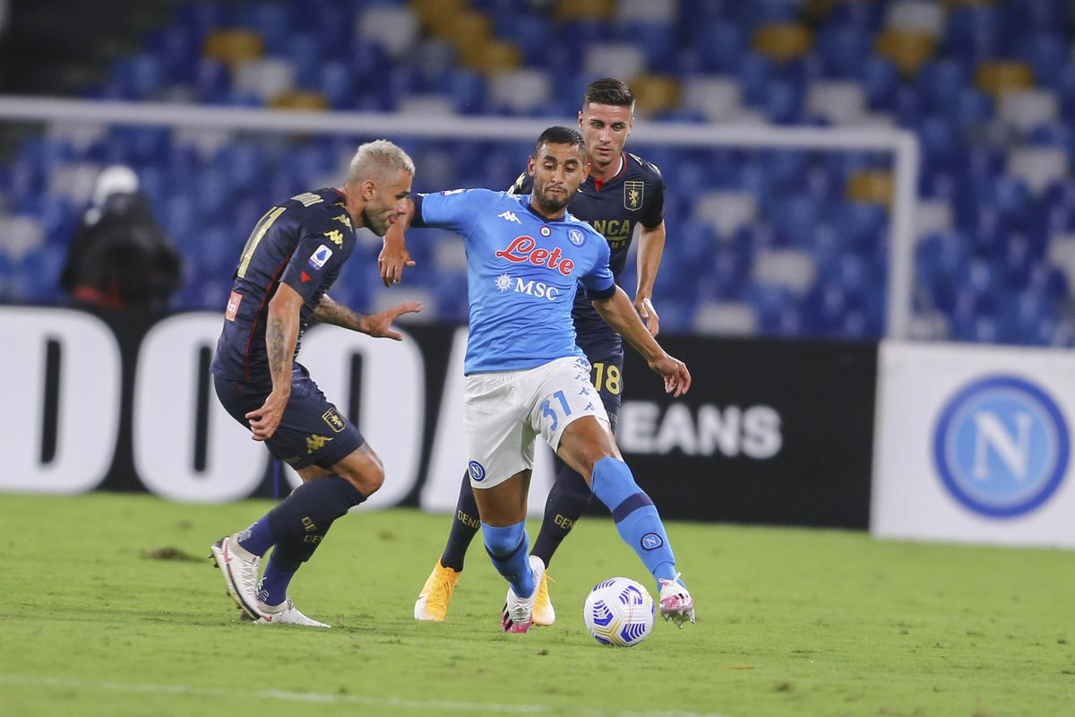 SSC Napoli's Algerian defender Faouzi Ghoulam (R) fights for...