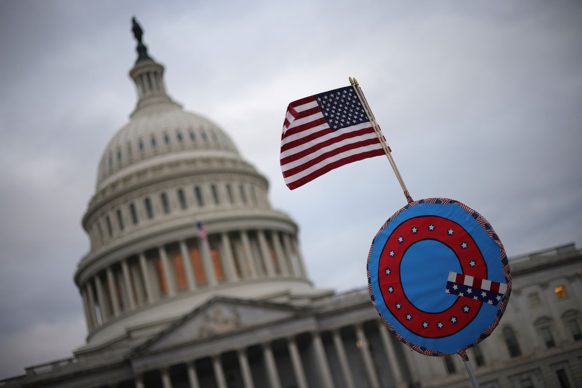 Supporters of former President Donald Trump flew a US flag with a QAnon symbol outside the Capitol on January 6th.