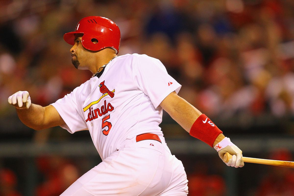 ST. LOUIS, MO - MAY 17: Albert Pujols #5 of the St. Louis Cardinals hits a single against the Philadelphia Phillies at Busch Stadium on May 17, 2011 in St. Louis, Missouri.  (Photo by Dilip Vishwanat/Getty Images)