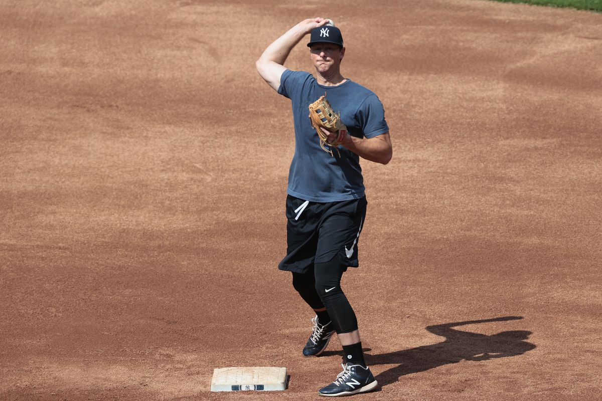 New York Yankees first baseman DJ LeMahieu throws the ball to first base during infield drills during summer workouts at Yankee Stadium.