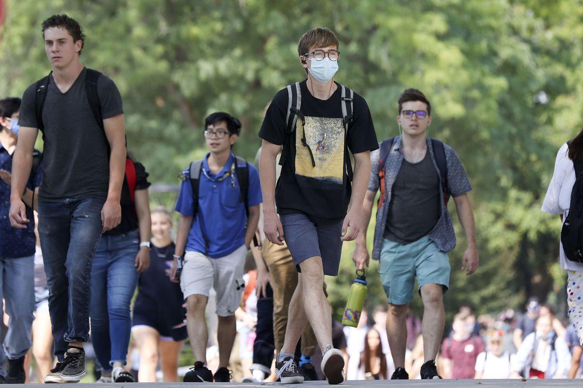 People walk on the University of Utah campus in Salt Lake City.
