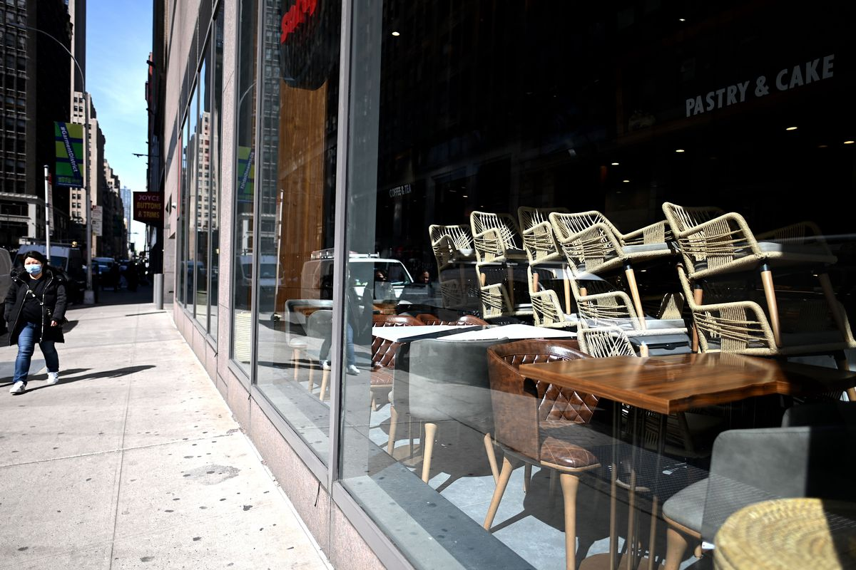 Chairs are stacked in a closed Cafe in Manhattan on March 16, 2020 in New York City.