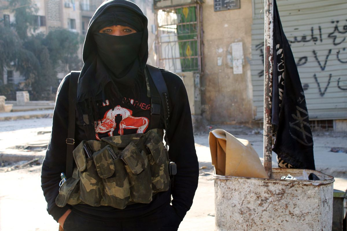 A member of the jihadist group al-Nusra Front stands in a street of the northern Syrian city of Aleppo on January 11, 2014.