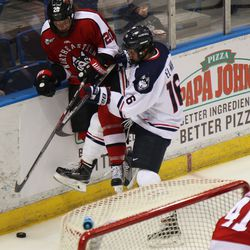 UConn's Karl El-Mir (16) checks  Northeastern's Eric Williams (20) into the boards.
