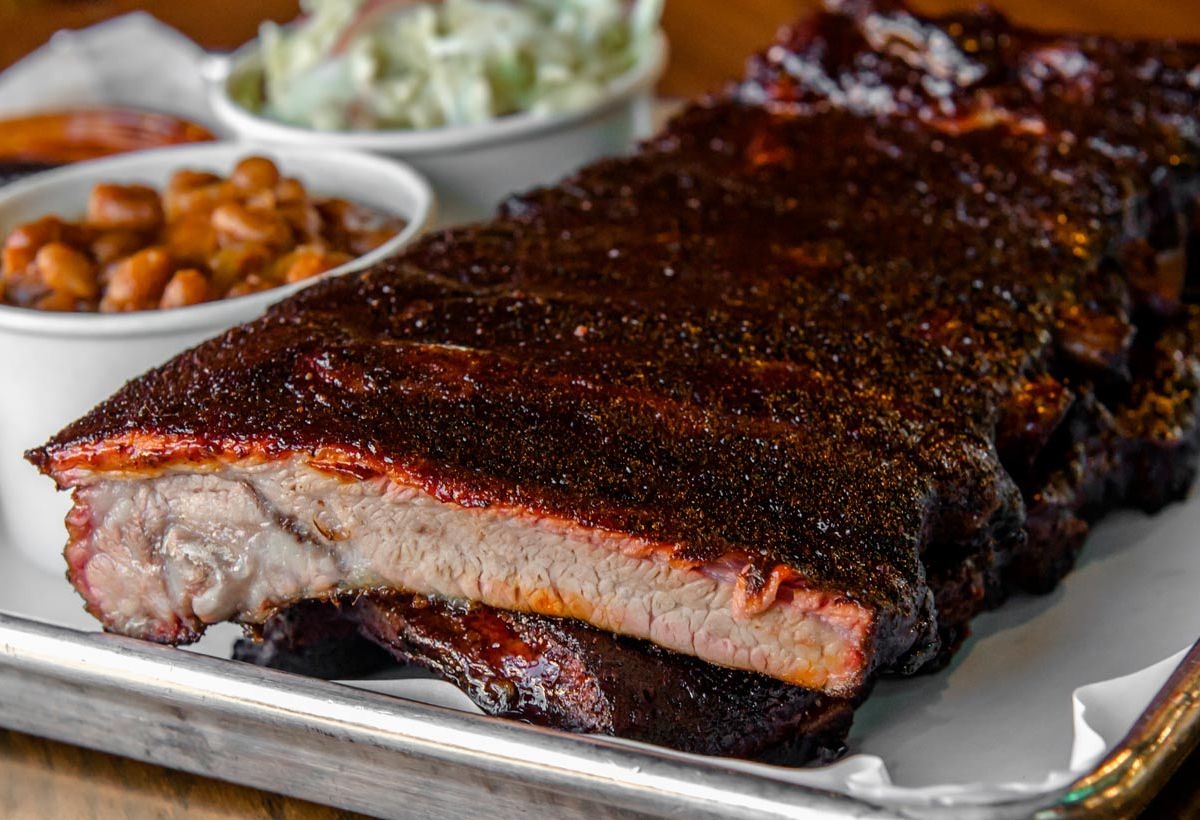 A platter of St. Louis-style ribs and sides.