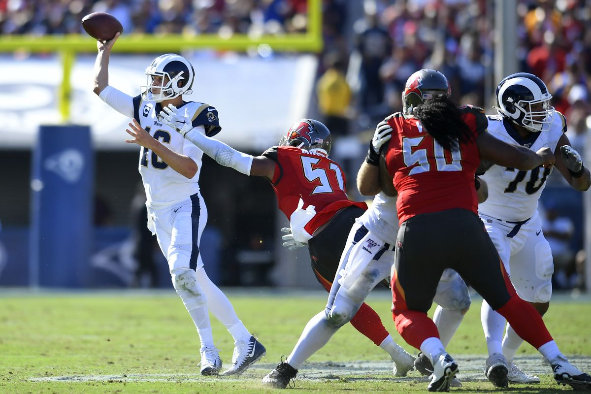 Jared Goff of the Los Angeles Rams gets away from Kevin Minter of the Tampa Bay Buccaneers to throw a pass at Los Angeles Memorial Coliseum on September 29, 2019 in Los Angeles, California.