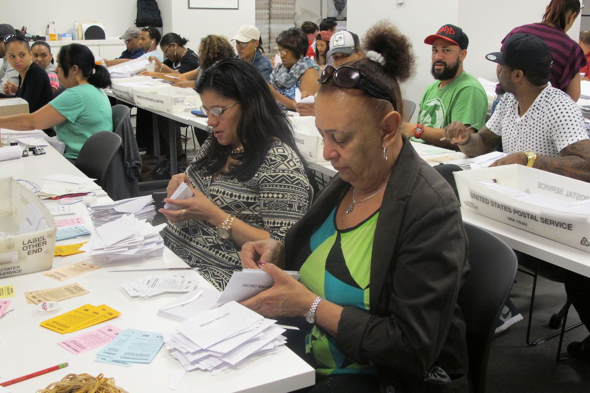 Ballot counters sort and scan votes on the United Federation of Teachers contract.