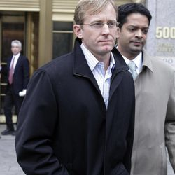 Joseph Skowron III, , center, of Greenwich, Connecticut, leaves Federal Court, in New York,  Wednesday, April 13, 2011. The Ivy League-trained physician who became a health care investment analyst surrendered Wednesday on charges that accuse him of evading $30 million in losses for a hedge fund by obtaining confidential information from a French doctor about clinical liver disease drug trials.