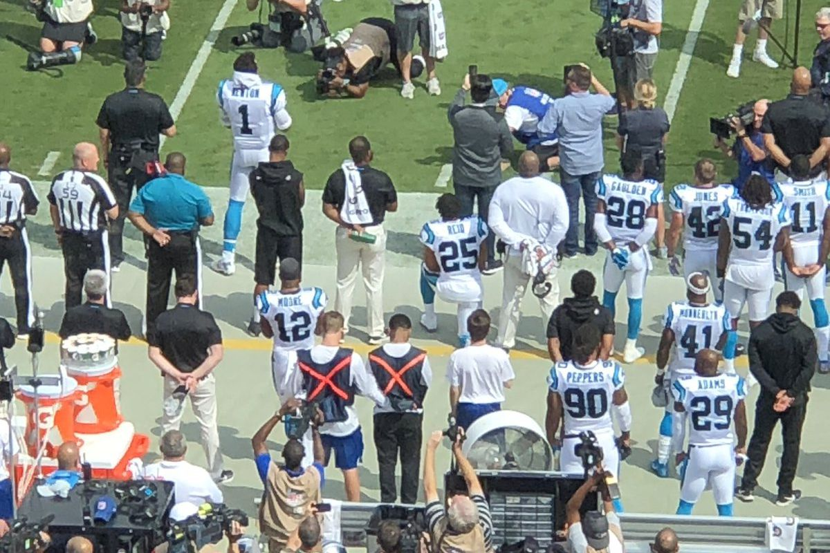Eric Reid kneels in protest before his first game with the Panthers 481176220