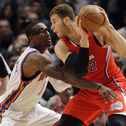 New York Knicks' Amare Stoudemire (1) defends Los Angeles Clippers' Blake Griffin (32) during the first half of an NBA basketball game, Wednesday, April 25, 2012, in New York.