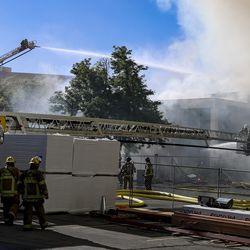 Firefighters battle a fire in the applied technology building, which is under construction, at the Salt Lake Community College campus at 4600 S. Redwood Road in Taylorsville on Monday, June 22, 2020.