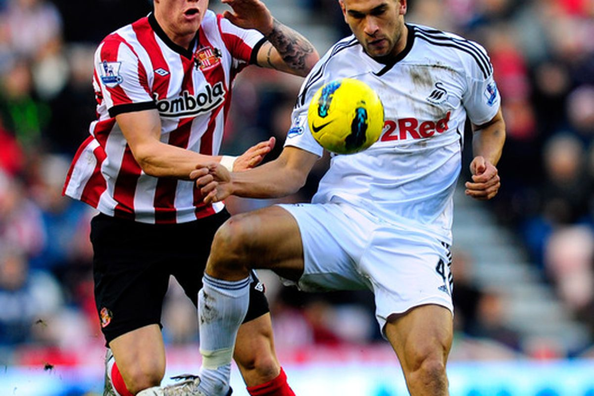 Sunderland player Connor Wickham (l) is challenged by Steven Caulker of Swansea during the Barclays Premier League game between Sunderland and Swansea City at Stadium of Light. (Photo by Stu Forster/Getty Images)